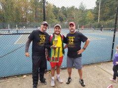Gold's Gym tennis director Peter Freeman, sportsmanship award winner Gustavo Gimenez, and platinum sponsor Arien Loden, from left.