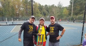 Gold's Gym tennis director Peter Freeman, sportsmanship award winner Gustavo Gimenez, and platinum sponsor Arien Loden, from left.