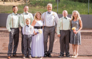 The bridal party photo was taken at the net, and then the couple and guests played a few rounds. The décor included ALTA tennis balls, and the groom's bowtie, boutonniere, buttons and cufflinks featured racquets.