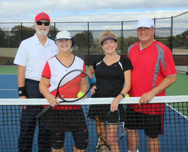 ALTA senior mixed doubles teams pose in front of net.