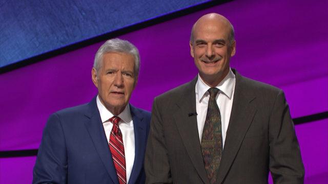 Alan Dunn, 5-time Jeopardy champion, with Alex Trebek.