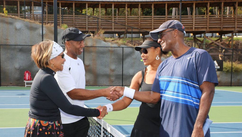 ALTA mixed doubles players at the net