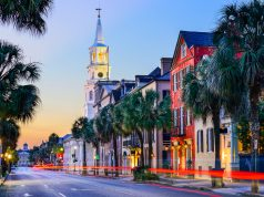 Charleston, South Carolina, USA cityscape in the historic French Quarter at twilight.