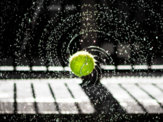 wet tennis ball flying through the air