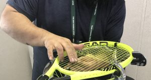 HEAD professional stringing a tennis racquet