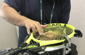 HEAD professional stringing a tennis racquet