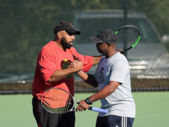 ALTA men's league players congratulating each other after a winning point.