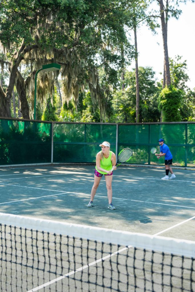 Mixed doubles players on a court at the Jekyll Island Tennis Center.