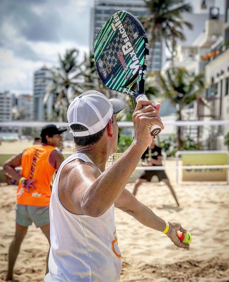 Guys playing beach tennis in Puerto Rico