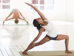 Woman in yoga pose in a yoga studio