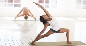 Woman in yoga pose in a yoga studio