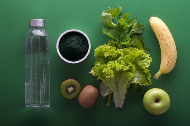 nutritious spread of water, green tea, kiwi, lettuce, banana, and apple