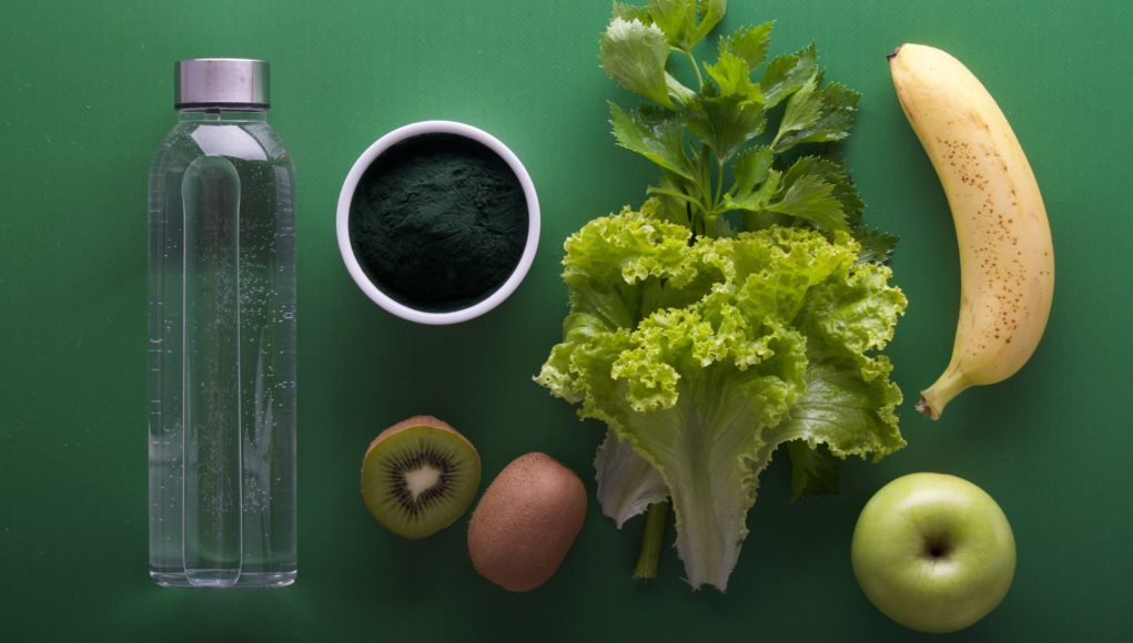 nutritious spread of water, green tea, kiwi, lettuce, banana, and apple