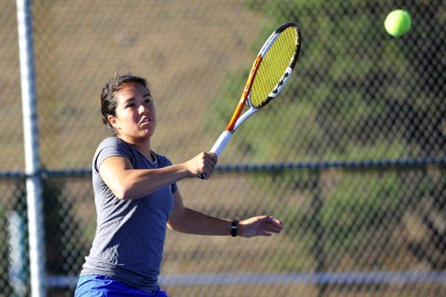 tennis player hitting a volley shot