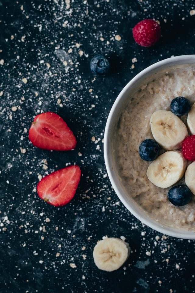 bowl of oatmeal with fresh fruit on top